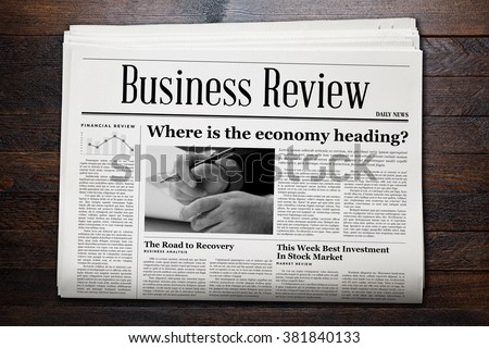 Business Newspaper on wooden background. - stock photo