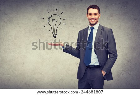 business, office, advertising and people concept - friendly young buisnessman showing light bulb on the palm of his hand - stock photo