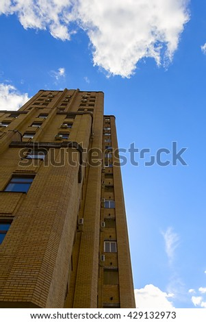 business office building against a blue sky background - stock photo