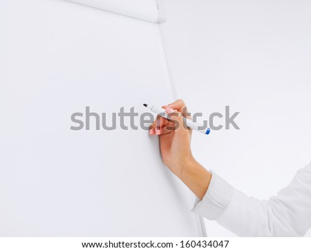 business, office, school and education concept - businesswoman working with flip board in office - stock photo
