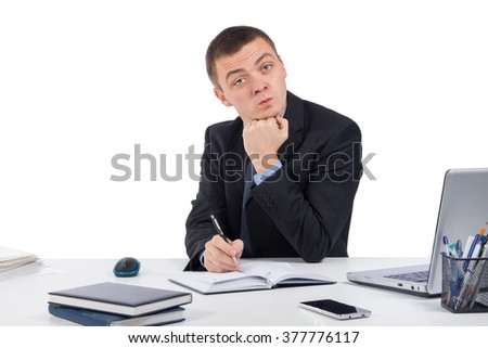 Business,office, technology, finances and internet concept - Serious businessman skeptically looking at you sitting at his desk isolated on white background.Human face expression  - stock photo