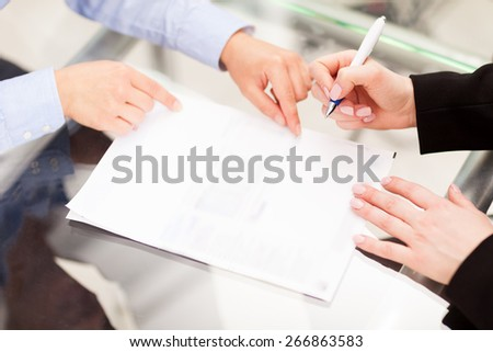 Business partner are signing the contract - stock photo