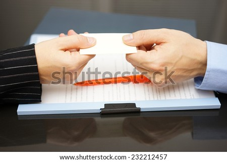 business partner is receiving business card - stock photo