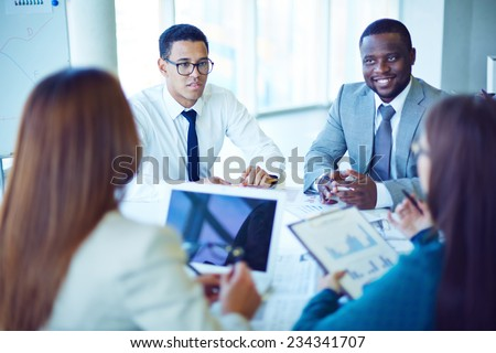 Business partners communicating at meeting - stock photo