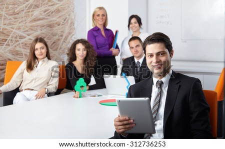 business partners discussing documents and ideas at meeting in office - stock photo