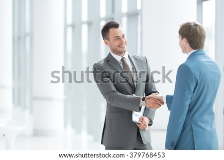 Business partners handshake in office - stock photo