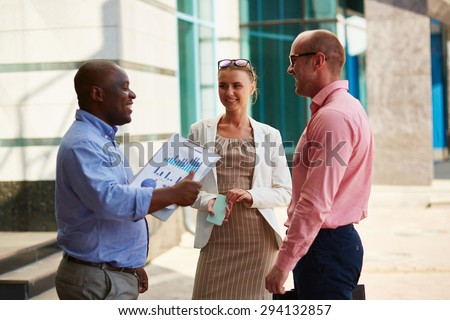 Business partners having meeting in urban environment - stock photo