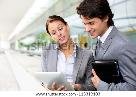 Business partners meeting outside building - stock photo