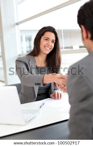 Business partners shaking hands after meeting - stock photo