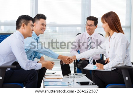 Business partners shaking hands at the meeting - stock photo