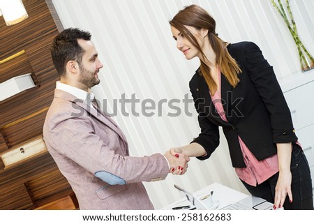 Business partners shaking hands, successful signing of the contract. Office. - stock photo