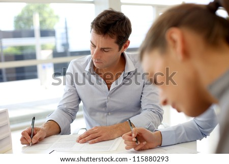 Business partners signing contractual documents - stock photo