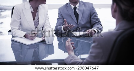 Business partners talking with their lawyer - stock photo