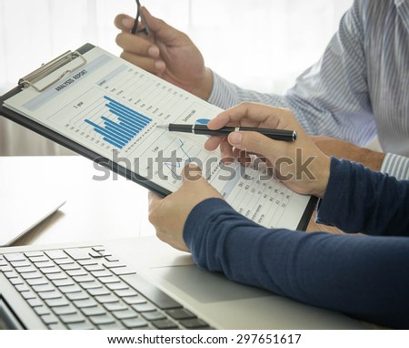 Business partners together to discuss the business plan at the meeting. - stock photo