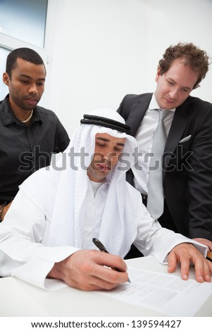 Business partners working in the office. Signing the contract - stock photo