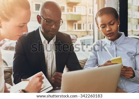 Business partners working, multi ethnic group of people, small office - stock photo