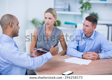 Business partners working together on the office - stock photo