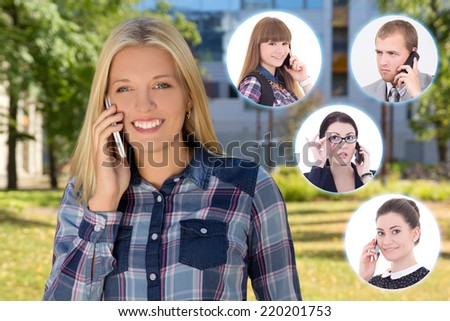 business partnership concept - young woman with phone and her colleagues - stock photo