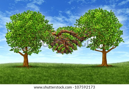 Business partnership growth success with two growing green trees in the shape of two hands hand shaking together as a financial symbol of agreement and contract between two companies or business men. - stock photo