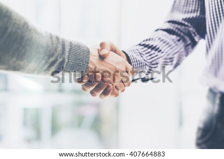 Business partnership meeting concept. Image businessmans handshake. Successful businessmen handshaking after good deal. Horizontal, blurred background - stock photo