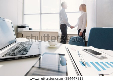 Business partnership of man and woman - stock photo