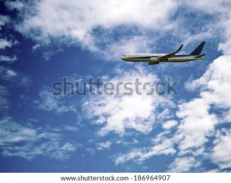 business passenger airplane in the air - stock photo