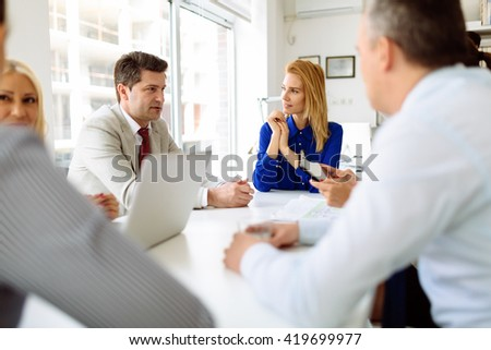 Business people and architects discussing future plans - stock photo
