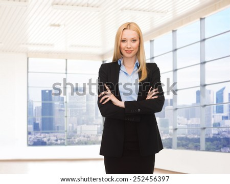 business, people and education concept - young smiling businesswoman over office room or new apartment background - stock photo