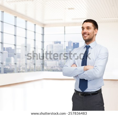 business, people and office concept - happy young buisnessman over office room or new apartment background - stock photo