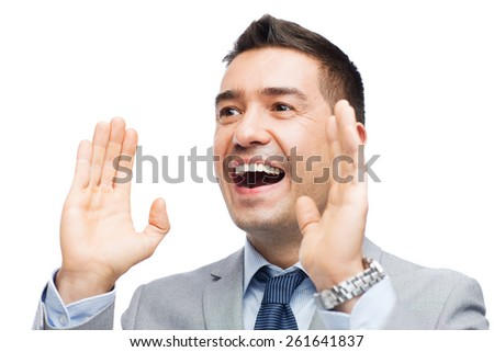business, people and public announcement concept - happy businessman in suit shouting - stock photo
