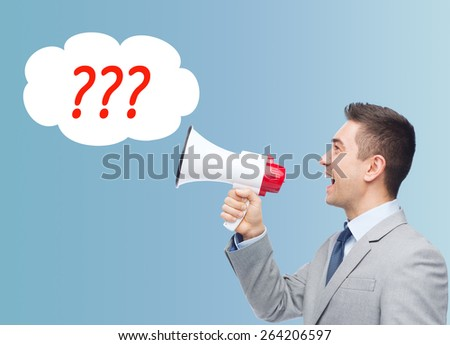 business, people and public announcement concept - happy businessman in suit speaking to megaphone over blue background - stock photo
