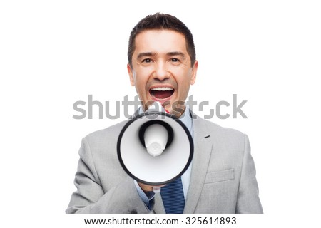 business, people and public announcement concept - happy businessman in suit speaking to megaphone - stock photo