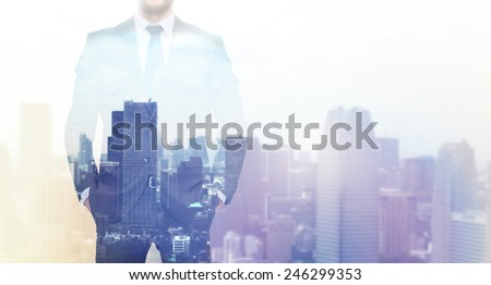 business, people and technology concept - double exposure of businessman over city background - stock photo