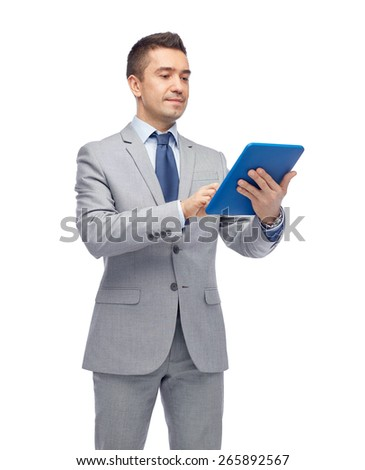 business, people and technology concept - happy businessman in suit holding tablet pc computer - stock photo