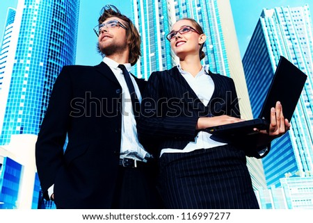 Business people are standing together in the big city. - stock photo