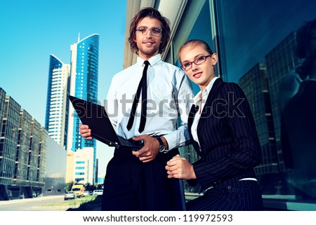 Business people are talking together in the big city. - stock photo