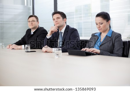 Business people at a meeting, listening to their superior - stock photo
