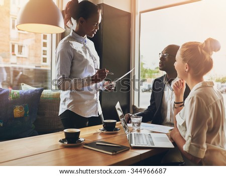 Business people at a meeting, small group, multi ethnic business, entrepreneur concept - stock photo