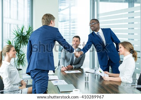 Business people at meeting indoors - stock photo