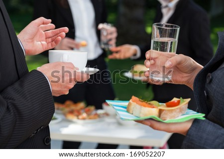 Business people at the meeting at the lunch buffet - stock photo