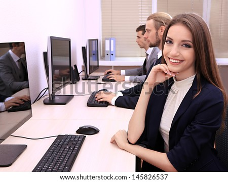 Business people at work place - stock photo