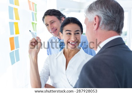 Business people brainstorming together in an office - stock photo