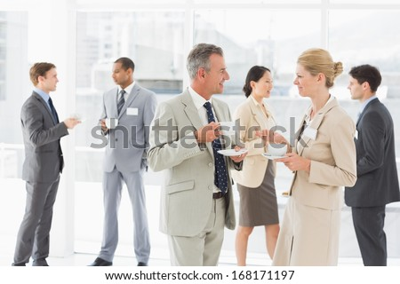Business people chatting at a conference in the office - stock photo