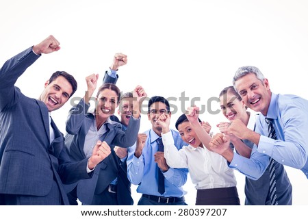 Business people cheering in office on white background - stock photo
