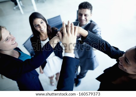 Business people cheering with hands together - stock photo