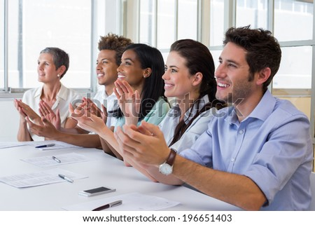 Business people clapping after presentation in the office - stock photo