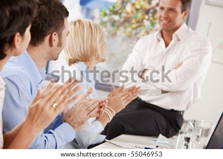 Business people clapping at the end of business presentation. - stock photo