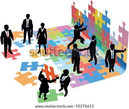Business people collaborate to put pieces together find solution to puzzle and build startup - stock photo