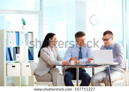 Business people collaborating at the round table indicating their equality - stock photo