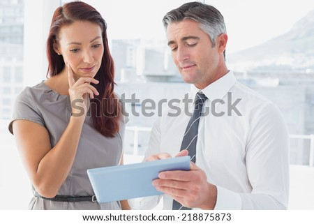 Business people comparing work notes in the office - stock photo